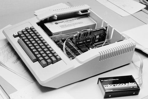 an Apple ][ computer with its case open